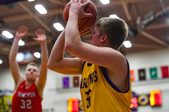 Watertown's Cooper Heiser lines up a three-point shot on Friday, Feb. 14, at the Watertown Civic Arena.