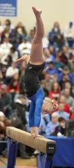 O'Gorman's Grace Miller turns on the beam during Friday's class AA team competition at the South Dakota State Gymnastics meet at the Golden Eagles Arena in Aberdeen.