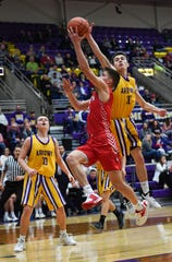 Watertown's Evan Falconer attempts to block a layup by Yankton's Cooper Cornemann on Friday, Feb. 14, at the Watertown Civic Arena.