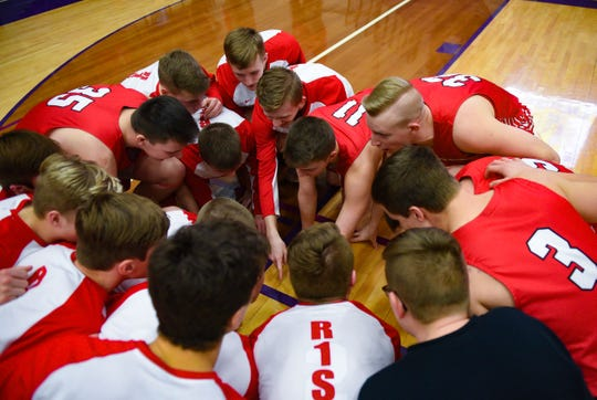 Yankton boys huddle low on the court to pump themselves up before their game against Watertown on Friday, Feb. 14, at the Watertown Civic Arena.