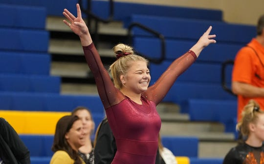 Harrisburg senior and Class AA all-around champion Kenzee Danielson competes on floor at the state gymnastics meet in Aberdeen.