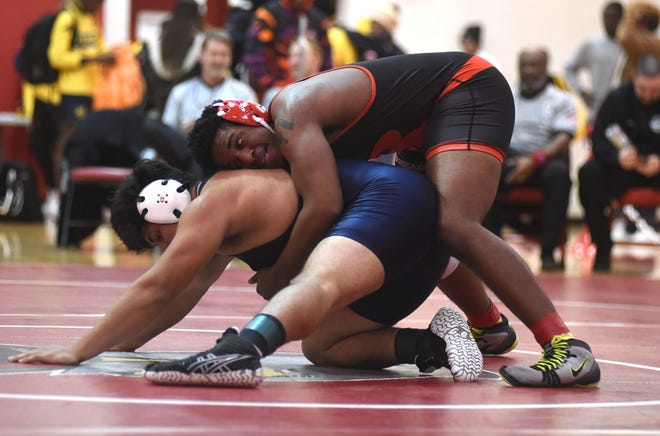 Riverheads' Jonah Robson wrestles Rappahannock County's Edgar Gonzales Flores in the Region 1A/B 220-pound championship match at Riverheads High School Saturday, February 15.
