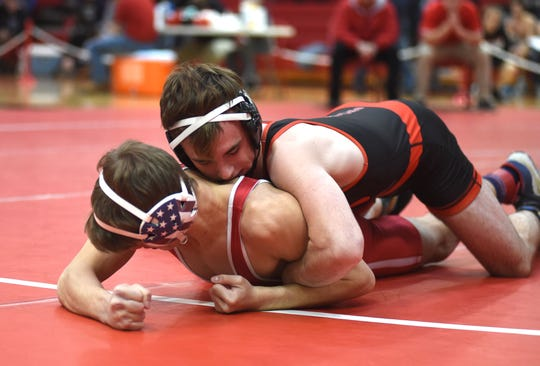 Riverheads' Lane Cash wrestles in the semifinal round of the Region 1A/B wrestling tournament held at Riverheads High School Saturday, February 15.