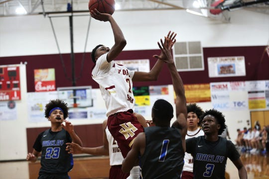 Florida High freshman Anthony Robinson goes up for a runner as Florida High's boys basketball team beat Maclay 65-58 during the District 1-3A final on Feb. 14, 2020.