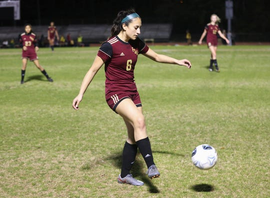 Florida High senior Lily Quijada plays a pass as Florida High's girls soccer team fell 4-3 in double overtime to Jacksonville Episcopal during a Region 1-3A semifinal on Feb. 14, 2020.