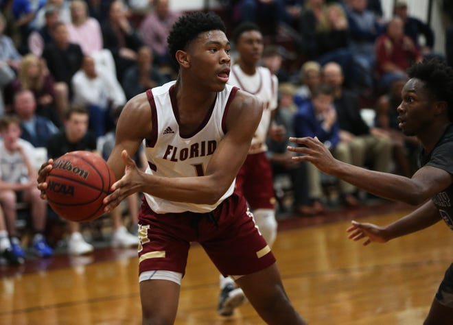 Florida High sophomore Jaylen Martin looks for a pass in the backcourt as Florida High's boys basketball team beat Maclay 65-58 during the District 1-3A final on Feb. 14, 2020.