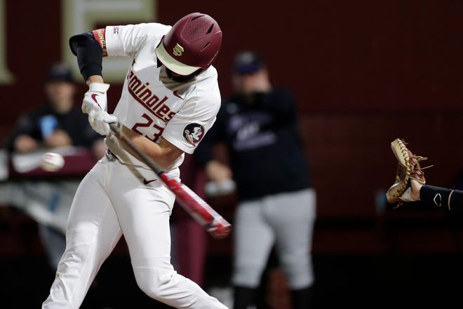 Florida State Seminoles outfielder Reese Albert (23) swings at the pitch. The Florida State Seminoles hosted the Niagara Purple Eagles on Friday, Feb. 14, 2020.