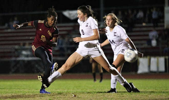 Florida High senior Janae Scott takes a shot for a goal as Florida High's girls soccer team fell 4-3 in double overtime to Jacksonville Episcopal during a Region 1-3A semifinal on Feb. 14, 2020.