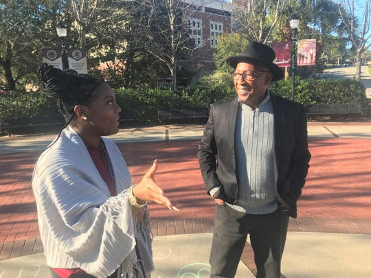 Current FSU student Beatrice Davis talks with Fred Flowers near the Integration Statue on campus. Davis leads tour groups of perspective students. She gives a history of Flowers as the first black athlete in FSU history.