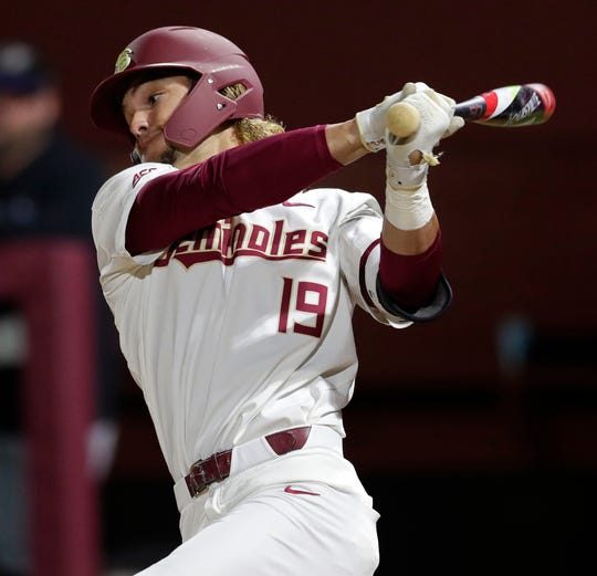 Florida State Seminoles outfielder Elijah Cabell (19) swings at the pitch. The Florida State Seminoles hosted the Niagara Purple Eagles on Friday, Feb. 14, 2020.