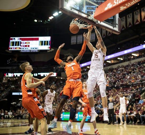 Florida State Seminoles center Dominik Olejniczak (15)  dunks on Syracuse Orange forward Quincy Guerrier (1). The Florida State Seminoles beat the Syracuse Orange 80-77 on Saturday, Feb. 15, 2020.