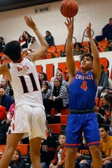 Canutillo's Sergio Burchell takes a shot against El Paso High's Kaleb Herrera during the game Friday, Feb. 14, at El Paso High in District 1-5A basketball.