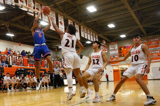 Canutillo's Mateo Burchell takes a shot against El Paso High's Abraham Guzman during the game Friday, Feb. 14, at El Paso High in District 1-5A basketball.