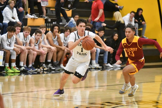Andrew Wilson drives past an Hillcrest player during Newbury Park's second-round loss at home Friday night.