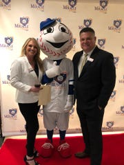 Rick and Jodie Pena, founders of the Miracle League of the 805, stand with homer at the nonprofit's third annual fundraiser in Camarillo. They hope to establish a baseball league for the special needs community.