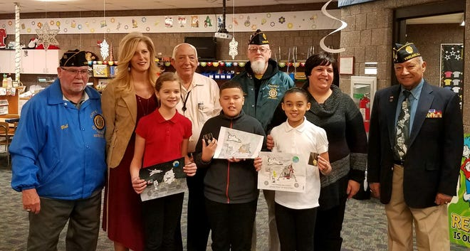 (First row, from left) Kristina Mykhaylevych, first, Landen Gonzalez, second, and Damiya Carter, third, all students from Dr. William Mennies Elementary School, were the winners of the New Jersey American Legion Coloring Contest, sponsored by American Legion Post No. 4, Vineland. They are pictured with (second row, from left) Bob Wolfe, adjutant, Post No. 4; Melanie Lovisone, principal, Dr. William Mennies Elementary School; John Provenzano, squad commander, Post No. 4; Grant Connelly, Post No. 4; Kristen Speakman, assistant principal, Mennies; and Juan Laboy, finance, Post No. 4.