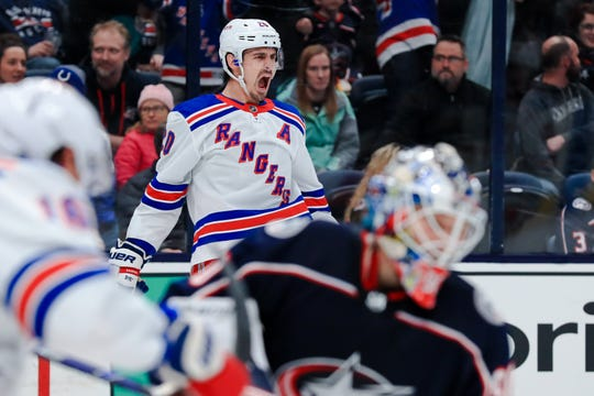 Feb 14, 2020; Columbus, Ohio, USA; New York Rangers left wing Chris Kreider (20) reacts to scoring a goal against the Columbus Blue Jackets in the third period at Nationwide Arena. Mandatory Credit: Aaron Doster-USA TODAY Sports