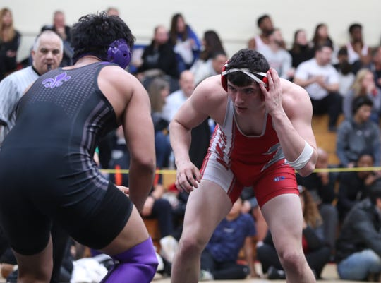 Tappan Zee's Desmond Kivlehan wrestles against New Rochelle's Chris Mejia in the first day of the Division I sectionals at Sleepy Hollow High School.