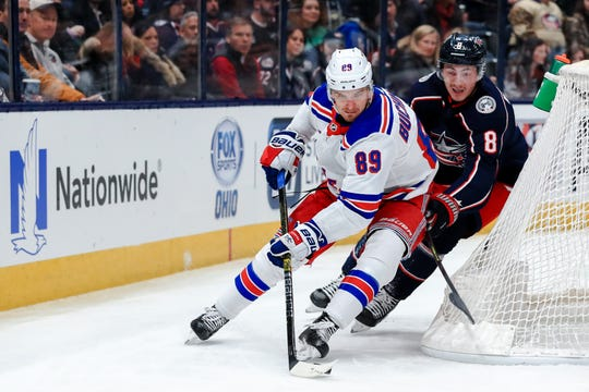 Feb 14, 2020; Columbus, Ohio, USA; New York Rangers right wing Pavel Buchnevich (89) controls the puck against Columbus Blue Jackets defenseman Zach Werenski (8) in the first period at Nationwide Arena. Mandatory Credit: Aaron Doster-USA TODAY Sports
