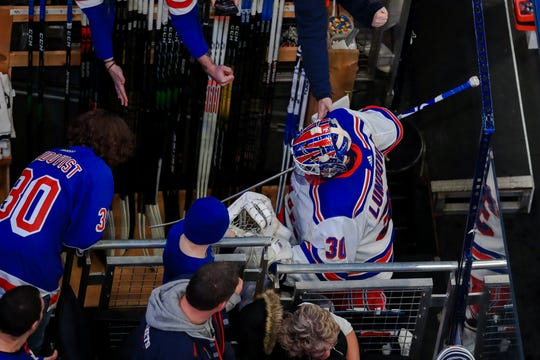 Feb 14, 2020; Columbus, Ohio, USA; New York Rangers goaltender Henrik Lundqvist (30) high fives fans as he skates off the ice after warmups prior to the game against the Columbus Blue Jackets at Nationwide Arena. Mandatory Credit: Aaron Doster-USA TODAY Sports
