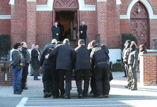 "Pallbearers carry the coffin of Noah ""Noe"" Hamer into St. Peter's & St. Mary's Church in West Haverstraw on Saturday, February 15, 2020.  According to police, Hamer was shot dead by recently fired funeral home director, Gerard O'Sullivan, in the parking lot of T.J. McGowan Sons Funeral Home in Haverstraw."