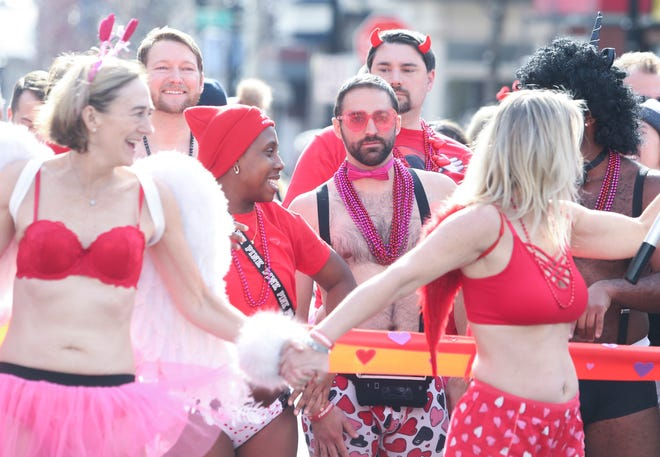 Participants run in a cheeky display for charity during the 2nd annual Cupid's Undie Run down Market Street in Wilmington, Del., on Saturday. The local event raised $22,000 toward a cure for neurofibromatosis.