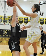 Tri-Valley's Lauren King makes a pass against Carrollton's Lucy Pridemore in Saturday's 65-25 victory in Division II sectional play.