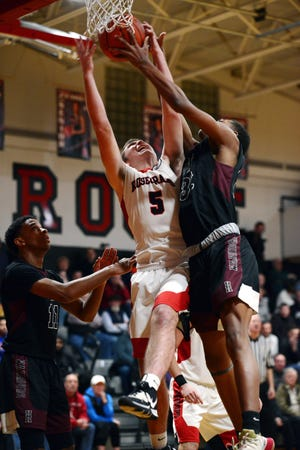 Marcus Browning, left, fights for a rebound with Nyelle Shaheed during Rosecrans' 72-59 loss to Canal Winchester Harvest Prep on Friday night at Rogge Gymnasium.