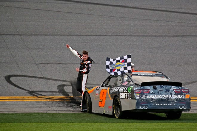 Feb: 15: Noah Gragson celebrates with the checkered flag after winning the NASCAR Racing Experience 300 at Daytona International Speedway.