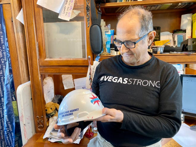 Greg Zanis holds his hard hat in his office in Aurora, Ill. on Feb. 14, 2020.