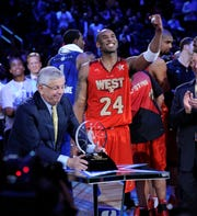 Kobe Bryant receives the 2011 All-Star MVP trophy from David Stern.