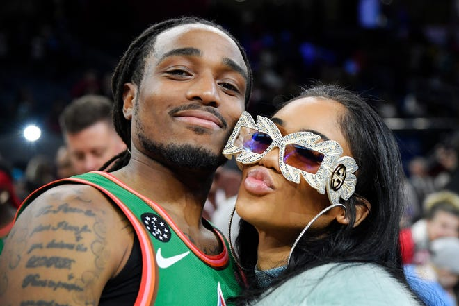 Quavo poses for a photo with Saweetie after the NBA All Star-Celebrity Game.
