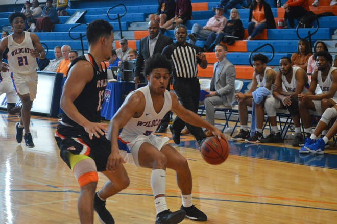 Louisiana College guard Denzel Austin (0) tries to get past a UT Dallas defender Saturday.