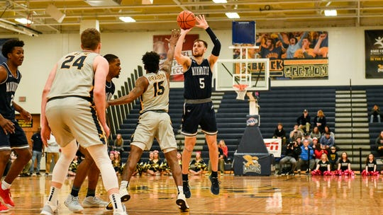 Monmouth's George Papas (5) hits one of his seven 3-pointers agaisnt Canisius in an 85071 victory on Friday night in Buffalo, N.Y.