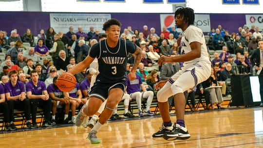 Monmouth's Deion Hammond (3) drives to the basket against Niagara in Lewiston, N.Y. on Sunday.