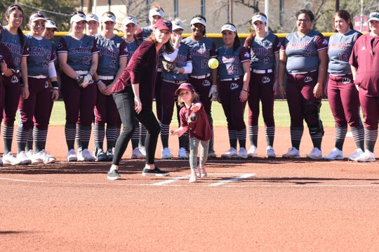 Kathi and Murray Edwards' granddaughter Annie throws out the ceremonial first pitch at Edwards Field on Sunday, Feb. 16, 2020. The War Hawks opened the field with a doubleheader against Southwestern following the ceremony.