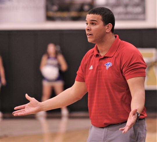 First-year Cooper coach Arsenio Geter reacts to a call during the Lady Cougars' playoff seeding game against Wylie on Friday, Feb. 14, 2020, at Abilene High's Eagle Gym. Cooper won the game 46-42 for the No. 3 seed coming of District 4-5A.