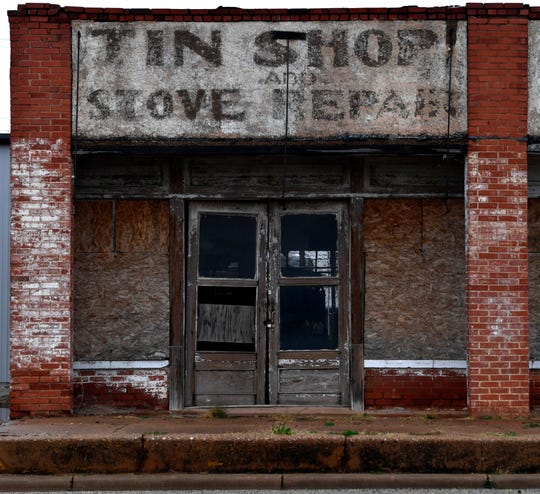 The sign of a faded business on North First Street in Merkel.