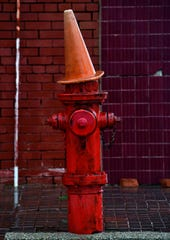 A traffic cone rests atop a fire hydrant on North Second Street in Merkel.