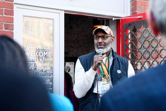 Reggie Tidwell speaks to a group before an opening ceremony at the new LEAF Global Arts Center in downtown Asheville on Feb. 14, 2020. The center brings all of LEAF's programs under one roof.