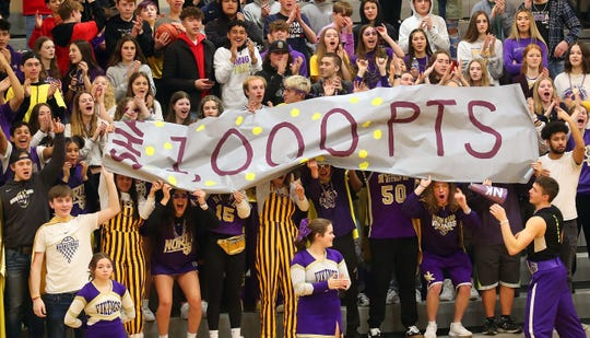 A banner celebrating Shaa Humphrey's 1000 point is unfurled by the North Kitsap student section during their game against Steilacoom in Poulsbo on Saturday, Feb. 15, 2020.