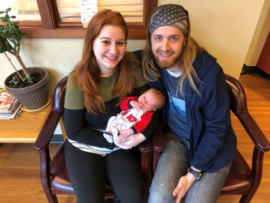 Nicole and Daniel Fahrnkopf hold their new baby Judah in Port Orchard. Nicole was unable to bank comp time because her supervisors said she couldn't perform her regular job at the Puget Sound Naval Shipyard while pregnant. She has filed a complaint.