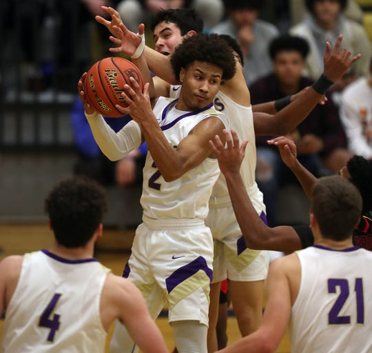 North Kitsap's Kobe McMillian and the Vikings play Tumwater on Saturday in the regional round of the Class 2A state tournament.