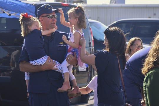 Crew members of the U.S. Coast Guard Vigilant returned to Cape Canaveral on Sunday