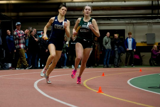 Essex's Lizzie Martell, left, passes St. Johnsbury's Katie Ryan on the final lap of the girls 4x400 during the Division I high school indoor track championships at UVM on Saturday, Feb. 16, 2020.