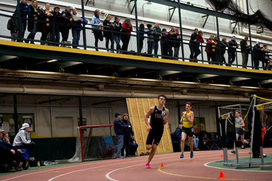 Essex's Henry Farrington cruises through the final corner of the boys 3,000 meters during the Division I high school indoor track championships at UVM on Saturday, Feb. 16, 2020.