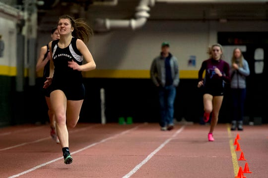 Mount Anthony's Rebecca Crosier charges to the finish line to win the girls 300 meter dash during the Division I high school indoor track championships at UVM on Saturday, Feb. 16, 2020.