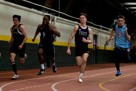 South Burlington's Mike North, right, Essex's Wyatt Lamell, Burlington's Bassiru Diawara and Mount Anthony's Jack Haynes near the finish line in the boys 55-meter dash during the Division I high school indoor track championships at UVM on Saturday, Feb. 16, 2020.