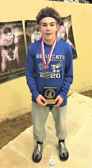 Walton-Verona's Spencer Moore displays his awards for 106-pound state champion KHSAA state championship wrestling tournament, Feb. 15, 2020, Alltech Arena, Lexington, Ky.