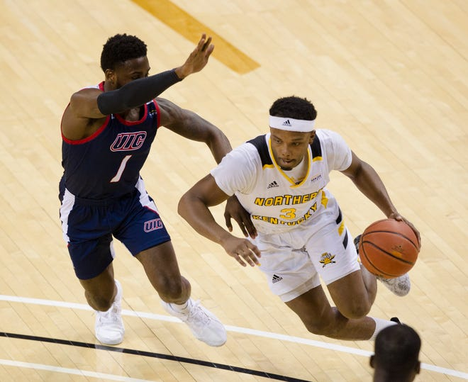 Northern Kentucky Norse guard Tre Cobbs (3) drives past Illinois-Chicago Flames guard Marcus Ottey (1) in the second half of the NCAA mens basketball game on Sunday, Feb. 16, 2020 at BB&T Arena in Highland Heights, Ky. Illinois-Chicago Flames defeated Northern Kentucky Norse 73-43.